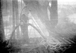 Construction worker inside a containment structure, obscured by a high airborne concentration of dust. (Image: CDC, phil.cdc.gov)