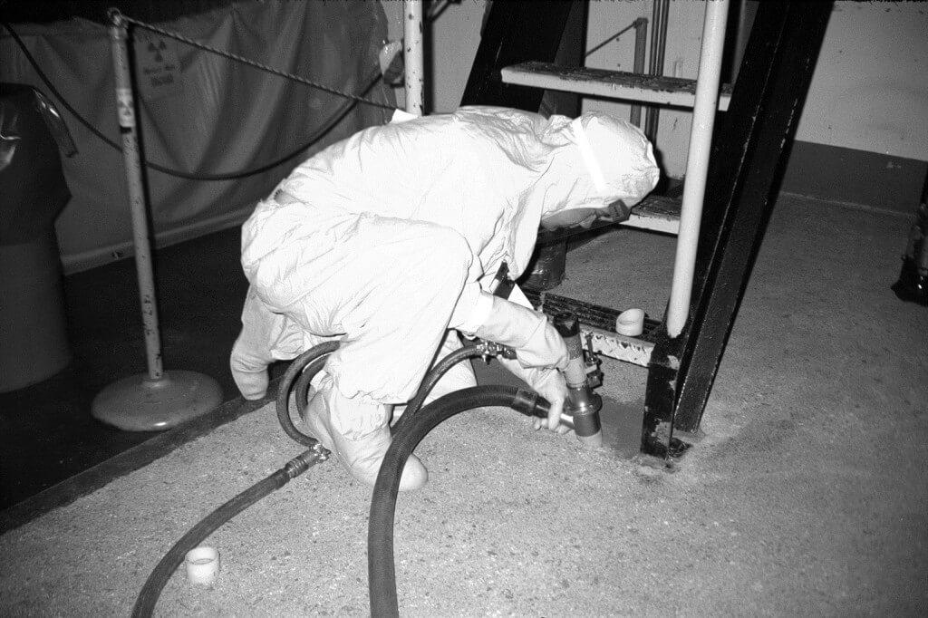 Worker using Corner Cutter needle gun
