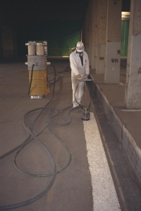 The SQUIRREL-III floor scabbler decontaminated 11,000 square feet (1,000 M2) of utility trenches that traced the perimeter of the facility floors.